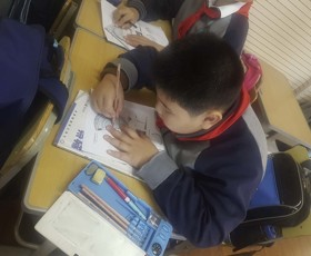 Shanghai exchange child using a protractor